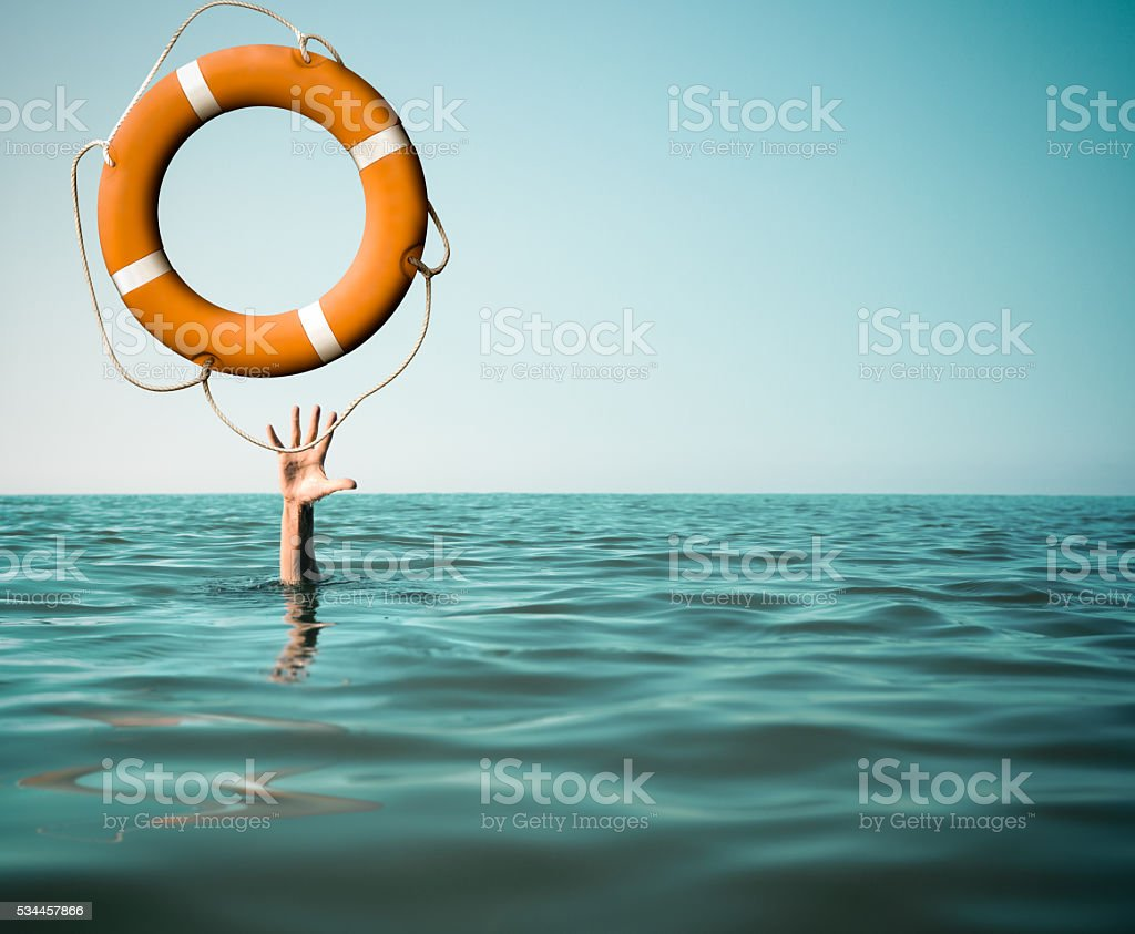 Drown man with rised hand getting lifebuoy help in sea stock photo