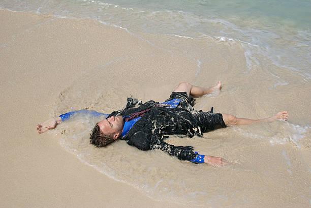 castaway geschäftsmann übertönt liegen in den wellen - die toteninsel stock-fotos und bilder