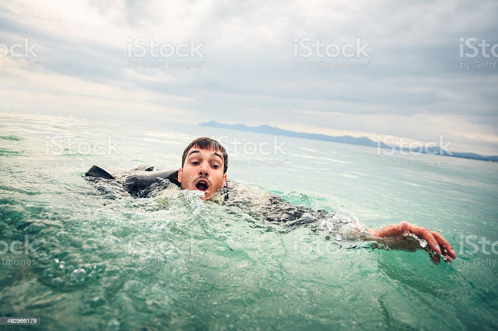 drowning businessman stock photo