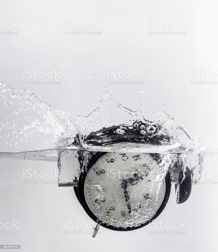 Drowning clock in the water stock photo