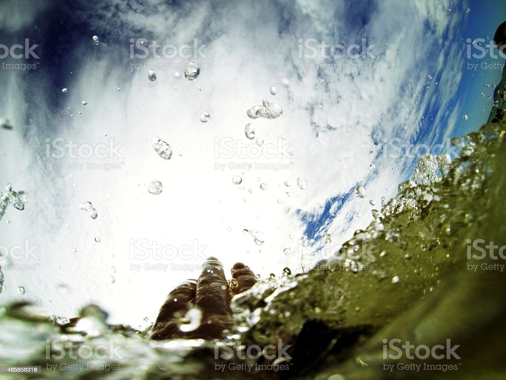 Drowning hand reaching out. stock photo