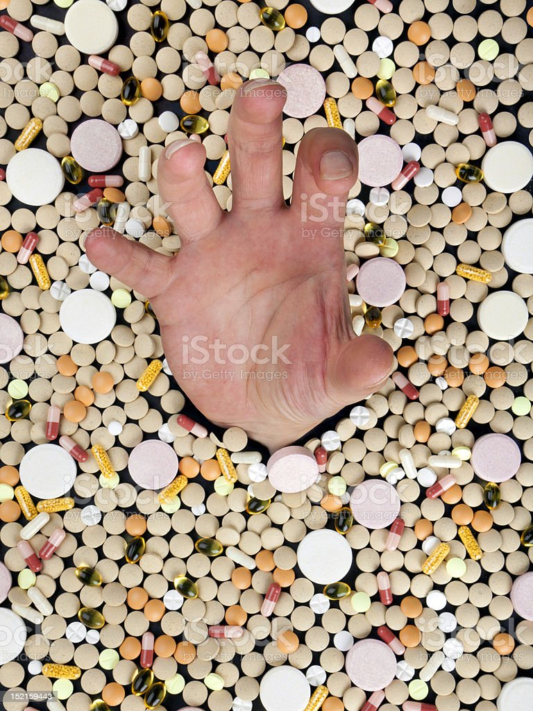 drowning in a sea of pills royalty-free stock photo