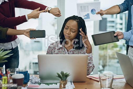 1067846662 istock photo Drowning in the demands of the workday 854972466