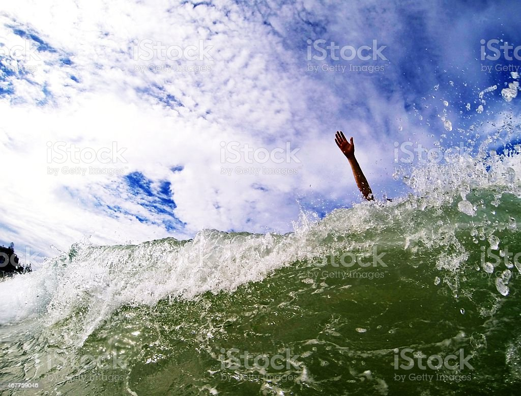 Drowning in wave. stock photo