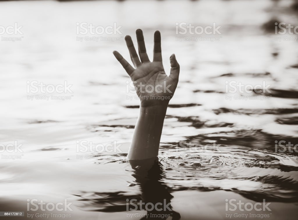 Drowning victims, Black and white hand of drowning man needing help. Failure and rescue concept. stock photo
