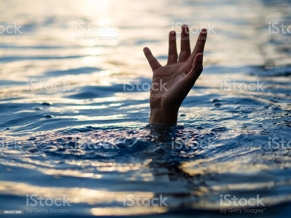Drowning victims, Hand of drowning man needing help. Failure and rescue concept. stock photo