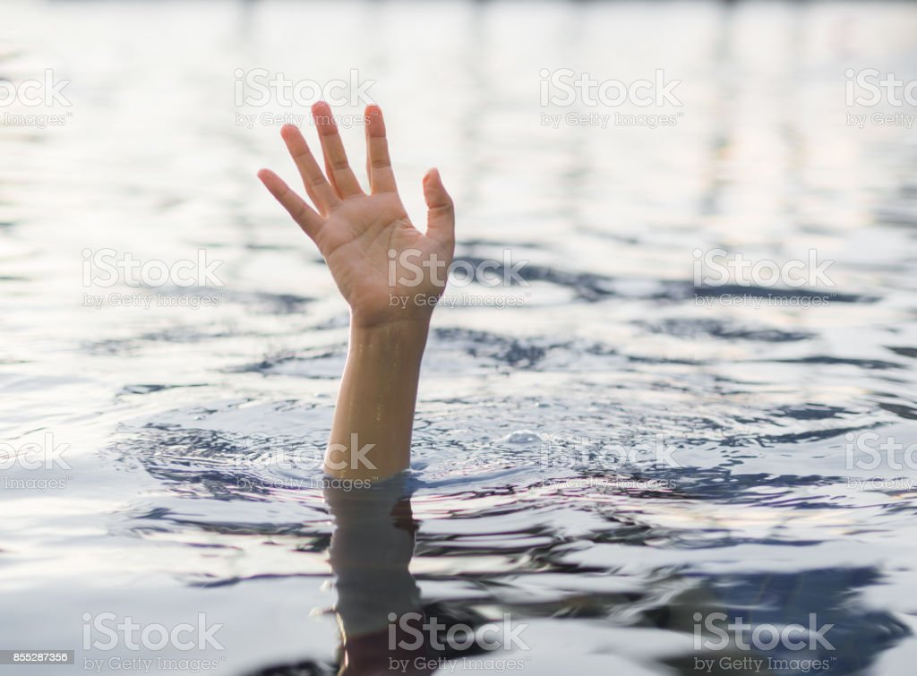 Drowning victims, Hand of drowning woman needing help.   Failure and rescue concept. stock photo