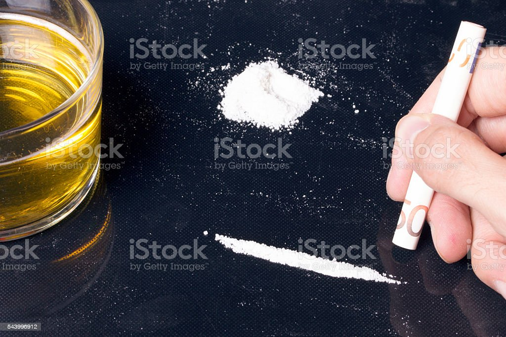 Cocaine addiction, combined with alcohol. Health danger.