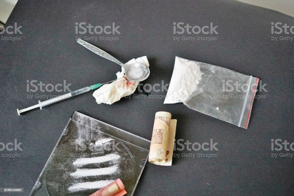 Preparing dose of heroin