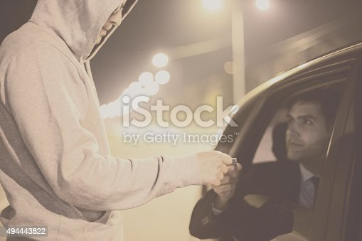Drug Sale,Pusher brings drugs to the car window to make his sale.