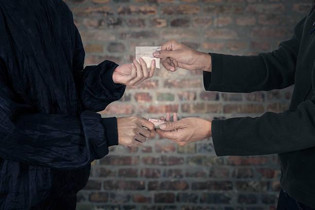 Drug abuse transaction Drug dealer taking money for heroine drug dealer stock pictures, royalty-free photos & images