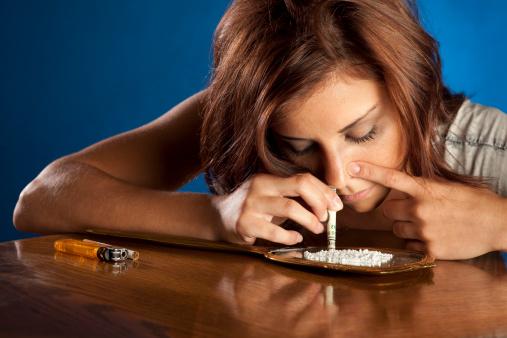 istock Drug Addict Girl Snorting Cocaine 157638313