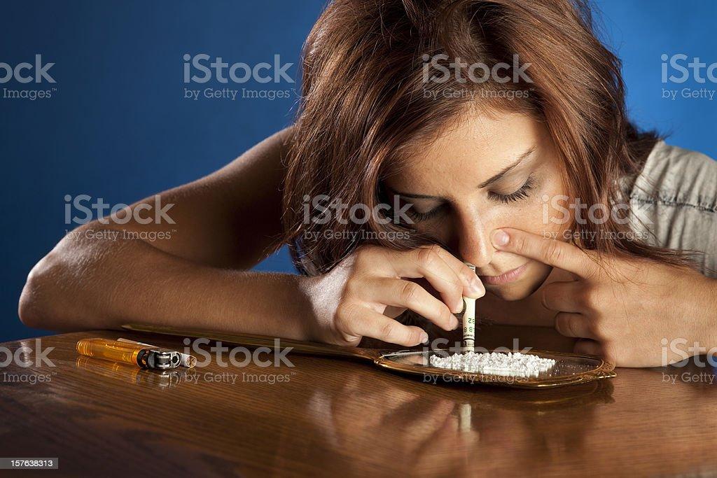 Drug Addict Girl Snorting Cocaine stock photo