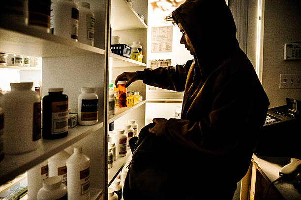 drug addict stealing prescriptions. - stealing crime stock photos and pictures
