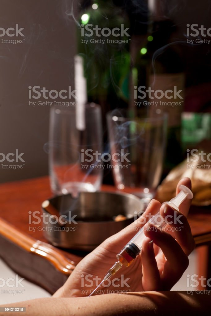Drug Addicted Girl With A Syringe Using Drugs Stock Photo