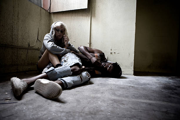 Drug addicts finding solace in their vice  heroin stock pictures, royalty-free photos & images