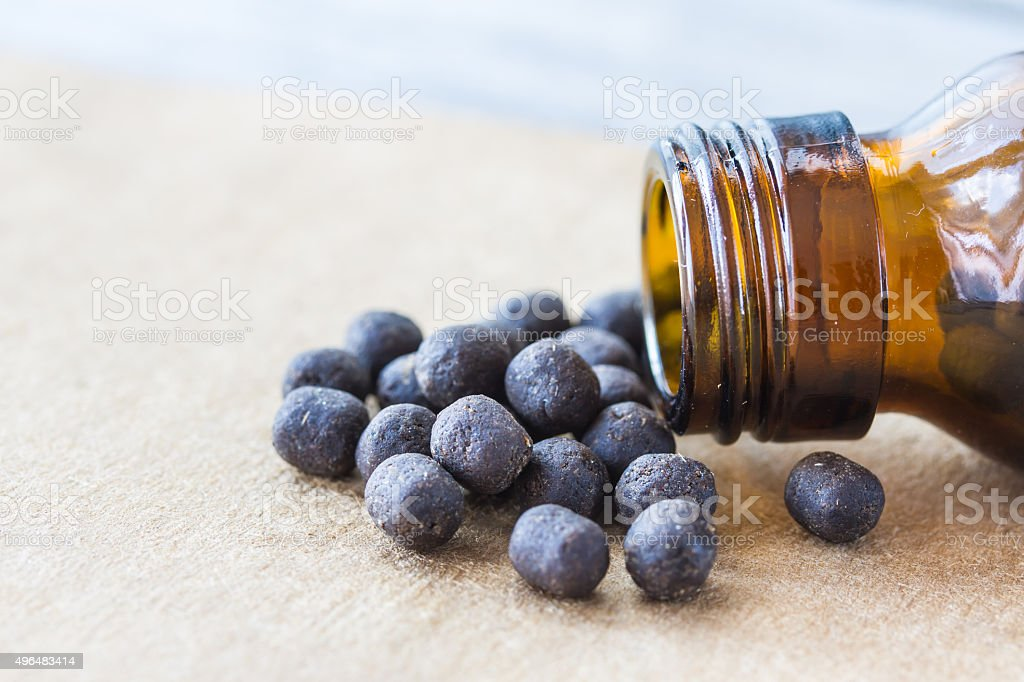 Drug black pigment dislodged from the bottle stock photo