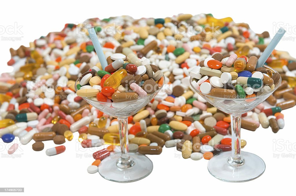 drug cocktails and pile of pills stock photo