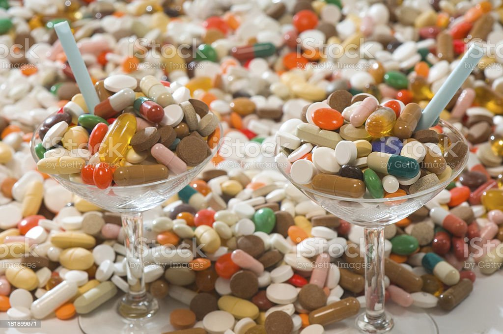 drug cocktails /w sea of pills stock photo