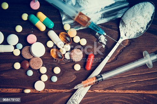 Drug concept. Use illicit Drug abuse .Addiction heroin.Injection, doping. Opium epidemic. Toning, selective focus.