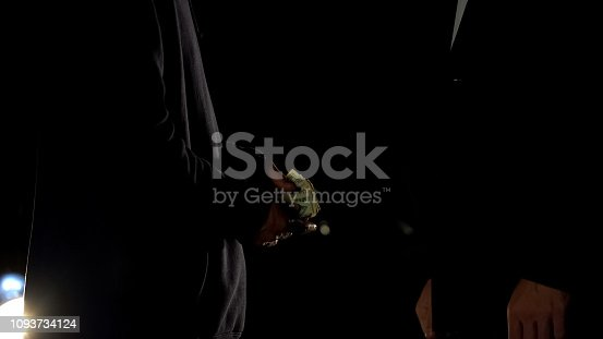 istock Drug dealer counting money selling dose to client, counterfeit money, ambush 1093734124