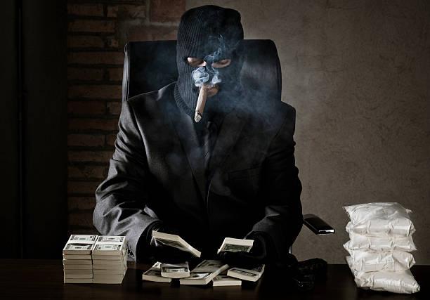 Drug dealer Drug dealer counting money in a warehouse drug dealer stock pictures, royalty-free photos & images