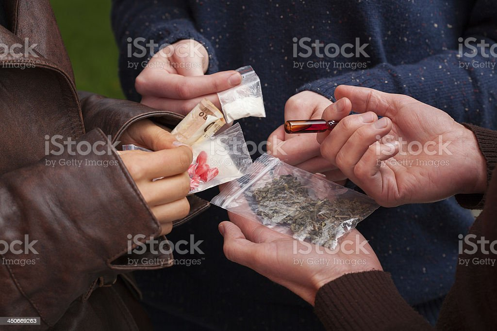Drug dealer selling drugs stock photo