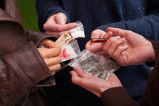 drug dealer selling drugs - narcotic stock pictures, royalty-free photos & images