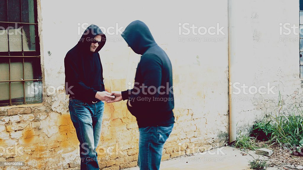 drug dealer selling portions of heroine stock photo