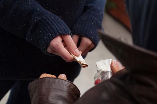 istock Drug dealer taking  money 450664241