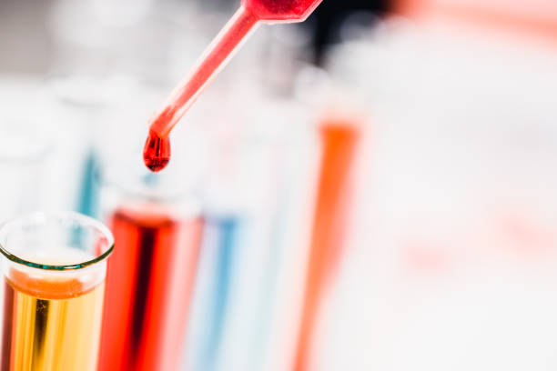 drug discovery, pharmacology and biotechnology concept. test tube and pipette with a sample drop. laboratory science background. stock photo