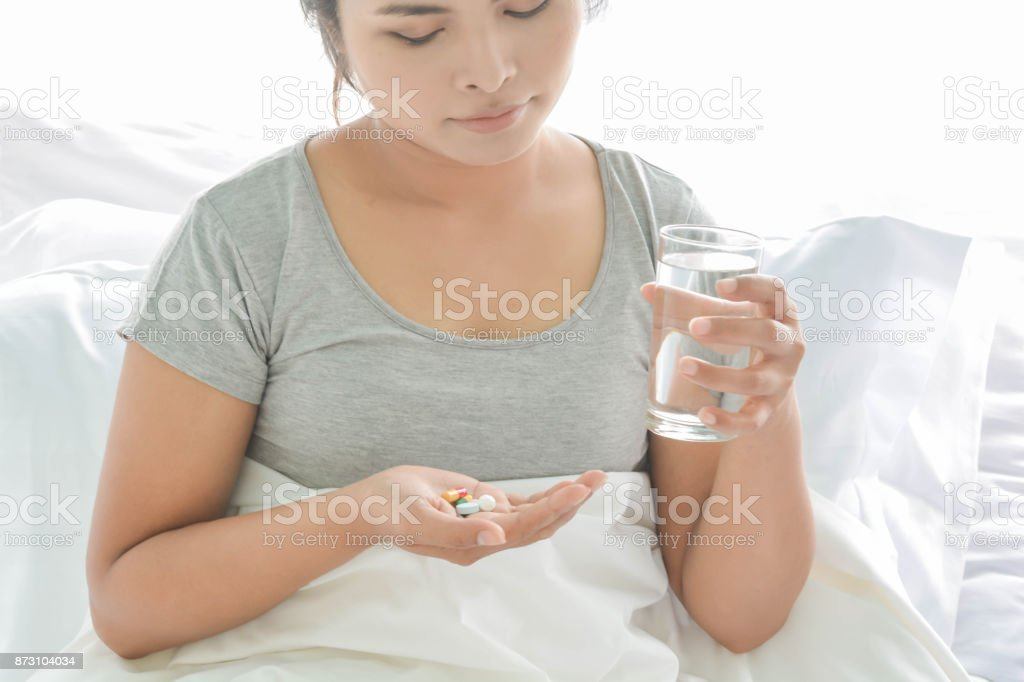 drug  in hand and old women stock photo