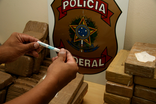 porto seguro, bahia / brazil - may 21, 2008: Seizure of cocaine by the Federal Police at the airport in the city of Porto Seguro, in the south of Bahia.