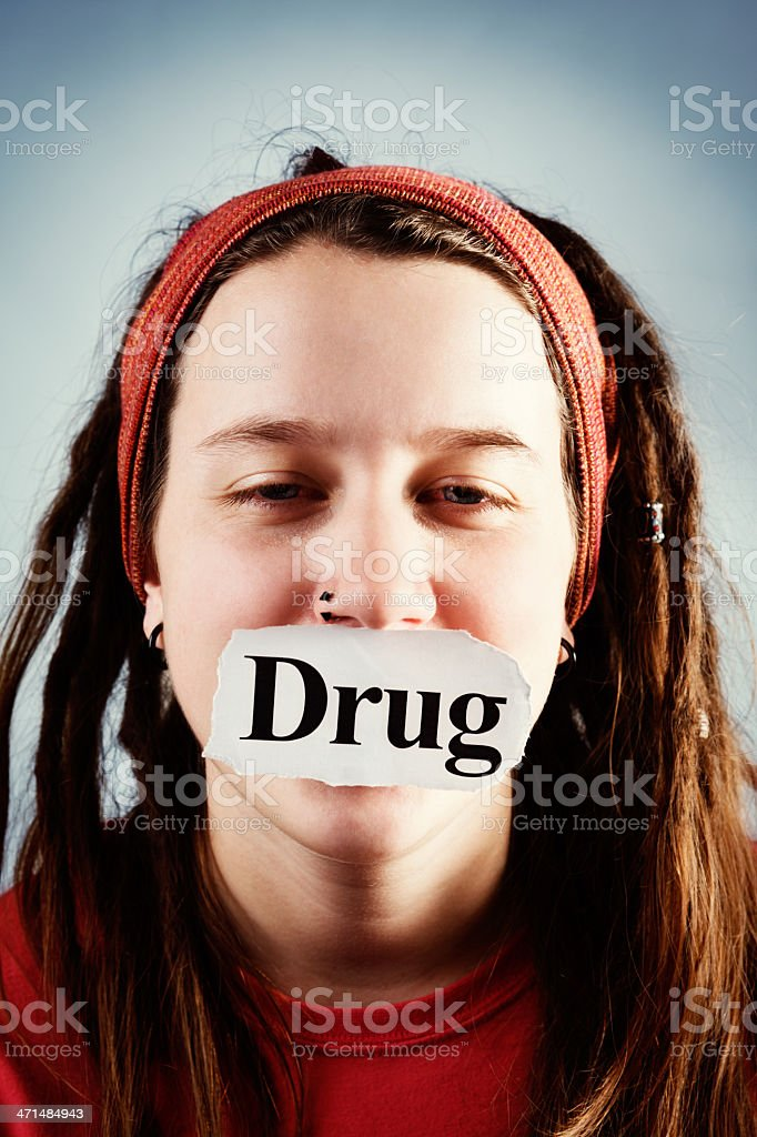 Drug sign gags teenage girl with dreadlocks and pierced nose royalty-free stock photo