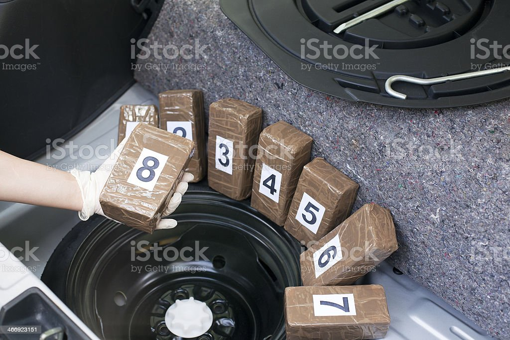 Drug smuggled in a car trunk royalty-free stock photo
