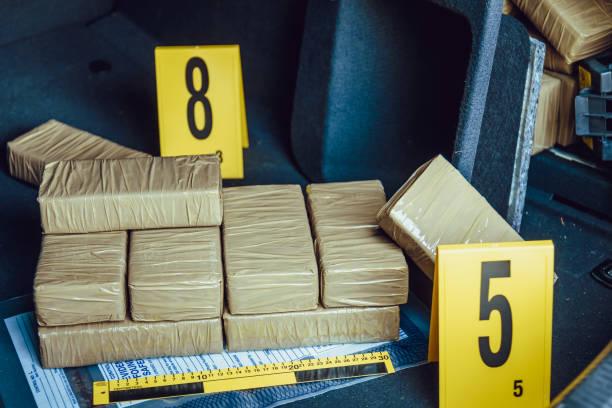 Drug smuggling Drugs in car trunk. Drug smuggling. Crime scene. smuggling stock pictures, royalty-free photos & images