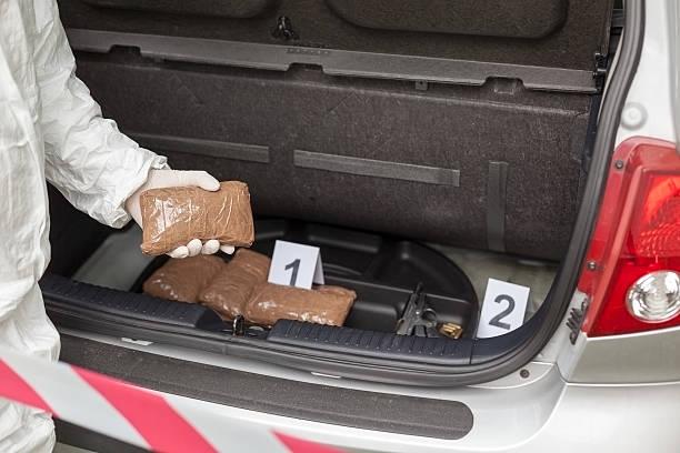 Drug smuggling Drug bundles smuggled in a car trunk smuggling stock pictures, royalty-free photos & images