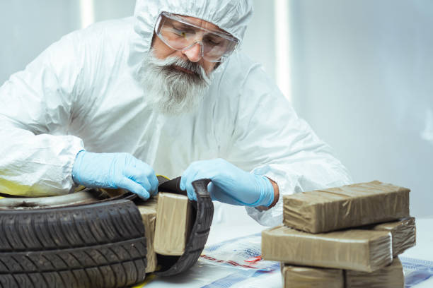Drug smuggling Packages of narcotics in car tire. Drug smuggling. smuggling stock pictures, royalty-free photos & images