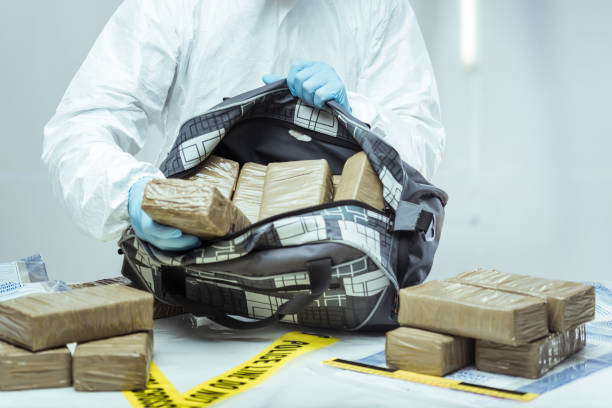 Drug smuggling Packages of narcotics in car tire. Drug smuggling. cocaine stock pictures, royalty-free photos & images