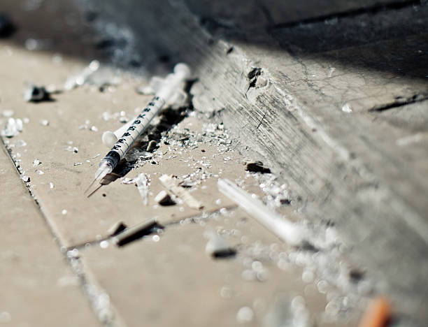 Drugs Addiction equipment Injection on the floor - selective focus heroin stock pictures, royalty-free photos & images