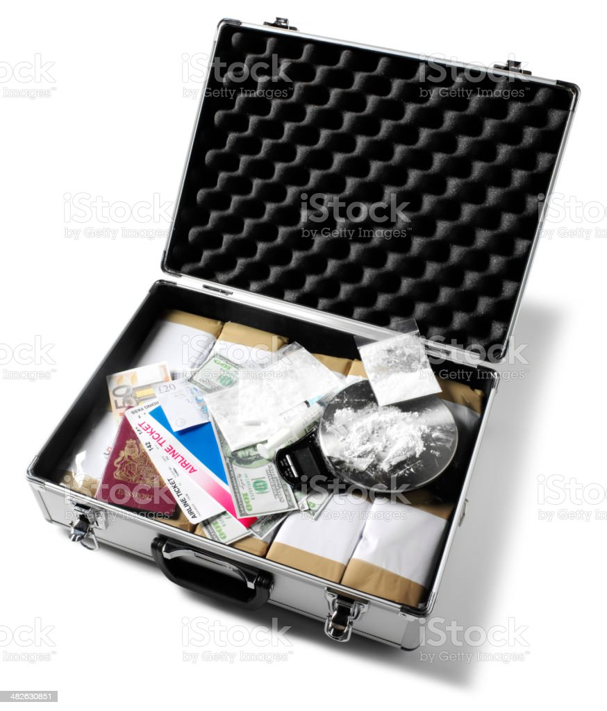 Drugs in a Briefcase with Flight Ticket and Passport royalty-free stock photo