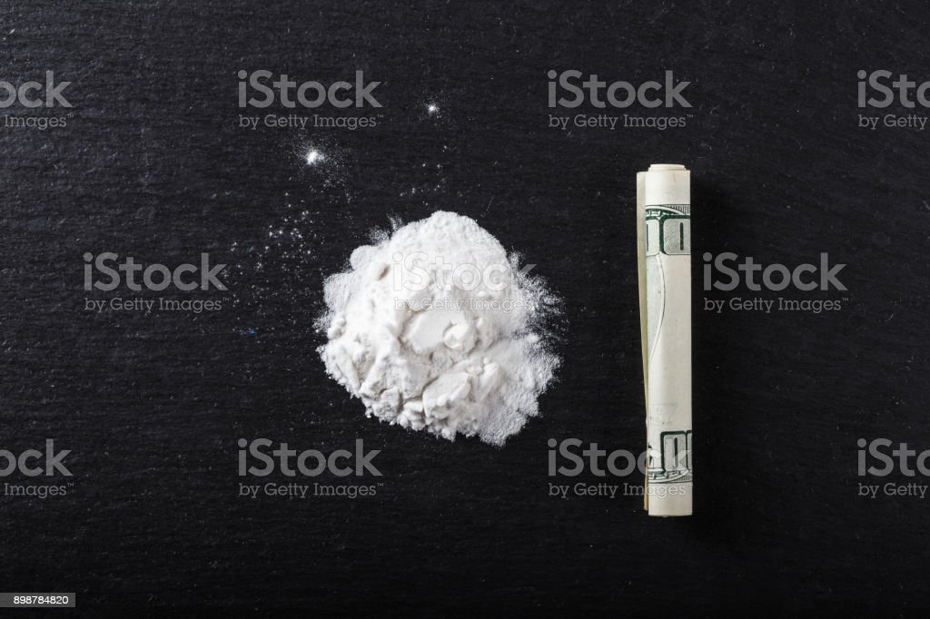 drugs strewn on the table. top view stock photo