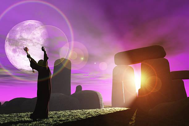 Druid greets the dawn at Stonehenge stock photo