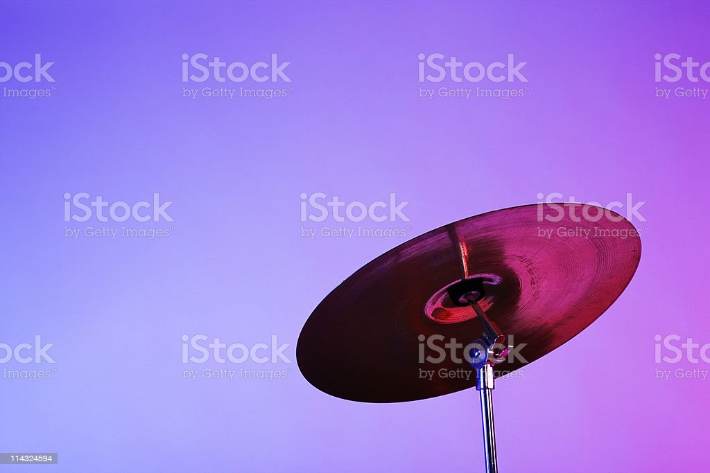 Drum kit cymbal in pink and blue light stock photo