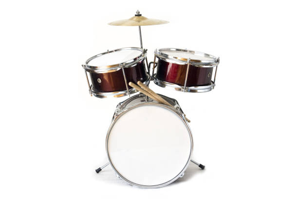 Drum kit isolated on white background Set of three drums with cymbal and drum sticks cymbal stock pictures, royalty-free photos & images