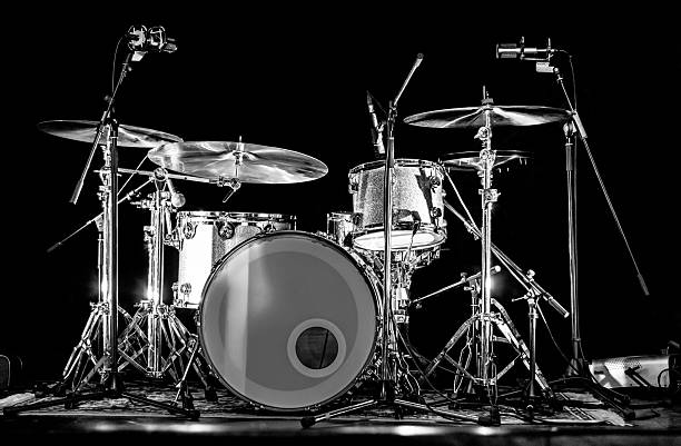 Drum Kit Set on Stage with Microphones Drum kit set on a stage with microphones, ready for the show. drum kit stock pictures, royalty-free photos & images