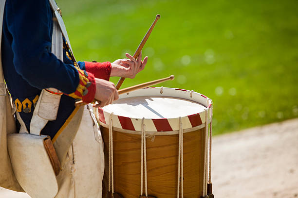 Drum on a parade re-enactment Fife and drum march at an old fort in a military re-enactment in Niagara Falls colonial style stock pictures, royalty-free photos & images