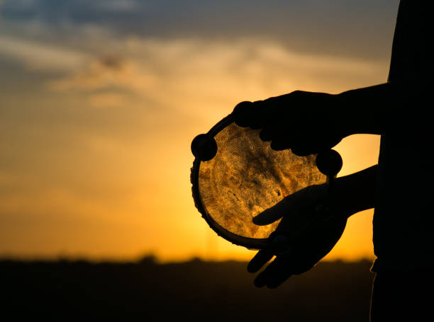 Drum or tambourine on a background of the sky at sunset stock photo