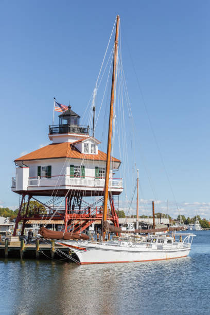 Drum Point Lighthouse And Sailboat, Solomon's Maryland stock photo