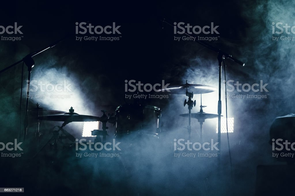 Drum set in smoke on a stage stock photo